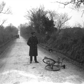 Photo:A Garda is pictured with Larry Griffin's bicycle on the road outside Stradbally, Co Waterford shortly after the postman disappeared on Christmas Day 1929.