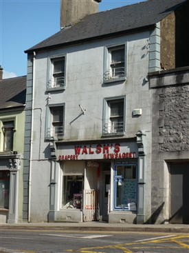 Photo:Front elevation of Briget's shop adjoining Ulster Bank on Abbey Street