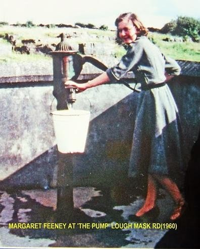 Photo:Margaret Feeney at the pump, Lough Mask Road 1960.