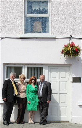 Photo:Councillor Michael Burke together with Ms. Maureen Dowd, her sister Peggy and Mr. Gerry Delaney outside the Meeneghan Family home