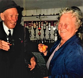 Photo:Mina McHugh ran a public house on Glebe St until her death in 1999. She is pictured with Paddy Flannery of Flannery's Bar, Cornmarket which still trades today.