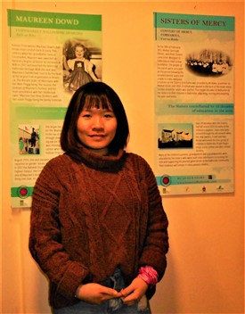 Photo:Vietnamese student Minh Tran with some of the historical boards she designed for Ballinrobe Women and its Hinterland.