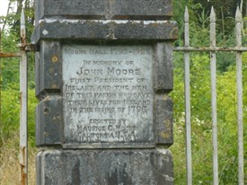Photo:Close-up of plaque commenerating John Moore, President