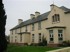 Photo:Parish Centre 2010.  Note the stained-glass window of the oratory on upper right