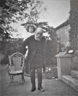 Photo:Dorothy on her grandfather's shoulders outside the old Rectory on Main Street; he was Archdeacon at the time in Ballinrobe and father of Marion, Dorothy's mother.