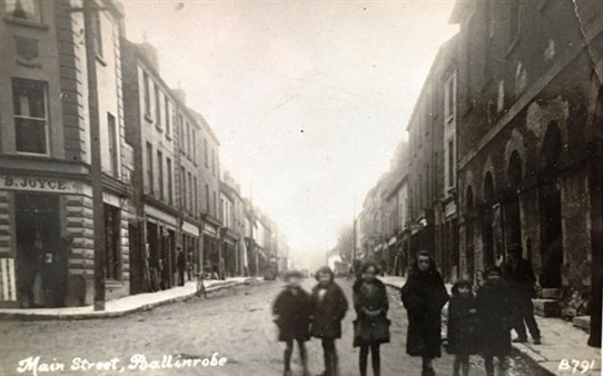 Photo:The photo of Main Street would be mid 1920's as it says on the back that May Morris ( my Aunt decd.) is on the left. She was born 1919. Also looks like there might be snow on the pavements or lots of mud).